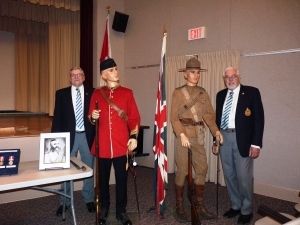 Our speakers and their guests for the evening.  From left: Gary, mannequin in Fenian Raid uniform, mannequin in Boer War uniform, and Earl