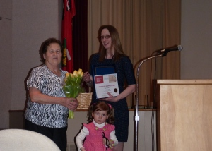 Earl Hann Volunteer of the Year Erika Suchan with her granddaughter, and Visitor Experience Coordinator Jillian Passmore