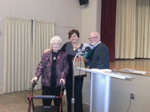 Special presentation for Executive Director Laura Suchan, centre, for her 25 years with the Oshawa Community Museum.  Past President Isabelle Hume, left, and Current President Merle Cole, right.