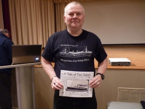 Ian Kinder with a copy of his book, A Tale of Two Sisters