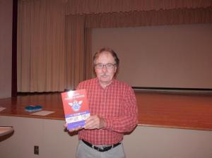 John McKenty with his publication, Canada Cycle and Motor: The CCM Story